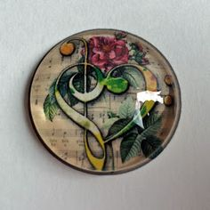 Finished photo glass cabochon still on larger piece of paper How To Make Photo, Glass Tile Pendant, Bottle Cap Art, Arts And Crafts, Diy Crafts, Badge Reel, Badge Holders, Larger, Projects To Try