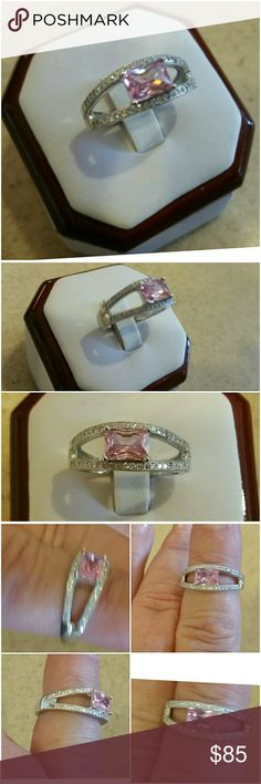 Genuine Pink Sapphire Solitaire Ring size 7 Wow!  Fantastic gem, surrounded on each side by many sparkling White Sapphires!   Set in 925 stamped Solid Sterling Silver. Please see all pictures for details. Brand New. Never Worn. Wholesale Prices. MSRP 595.00 Jewelry Rings