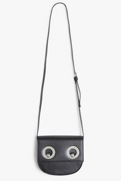 A shoulder bag with a two-eyelet close that looks quite like a face. O_O