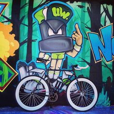A Pure Fix Mike against an art wall. #bike #bicycle #fixie #fixedgear #art #streetart #graffiti