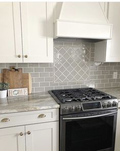 tiles Backsplash Beautiful kitchen backsplash made with our Dove Gray Handcrafted glazed subway tiles and Dove Gray Arabesque. Stocked in the USA and ships out in business days. Grey Kitchen Cabinets, Kitchen Cabinet Design, White Cabinets, Kitchen Designs, Gray Subway Tile Backsplash, Subway Tiles, Backsplash Ideas, Home Design, Design Ideas
