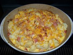 Cauliflower Ham Casserole 1 pound ham 1 16 oz bag frozen cauliflower, 2 c. cheese, 1 egg ½ cup almond milk ¼ cup heavy cream 1 T minced onion 1 t  garlic powder ¼ cup crushed pork rinds, Preheat oven to 325F.  Bake for 40 minutes. Makes 4 servings Net carbs per serving: 6 g