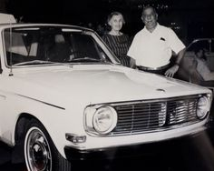 "Mid 60's original #Volvo 140 series and our grandparents, Alice and Fred ""Tokie"" Jaffarian at a Volvo dealer meeting to check out the new product. #AntiqueCar #ClassicCar"