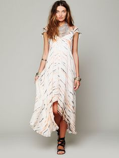 "Free People Tie Dye Cap Sleeve Maxi, $350.00  Tie dye patterned silk cap sleeved maxi dress with ""V""-neckline in front. Light ruching of fabric at top of each shoulder. Comes with slip to wear underneath. Super soft and lightweight. A stunning piece to welcome in the spring with!   *By Lotta Stensson *100% Silk  *Dry Clean Only  *Import  Measurements for Small: Length at Front: 38""  Length at Back: 55""  Bust (all around): 35""  Sleeve Length: 7 1/2""  Armhole Drop: 8"""