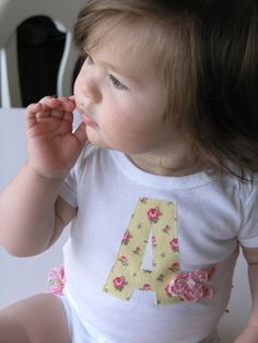 Baby ruffled onesie.   Monogram & embellished with a flower.  DIY sewing inspiration.