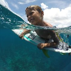 GoPro Featured Photographer and Athlete - @anthony_walsh_  About the Shot: I love this photo of my son Damien playing on my board after a #surf in #Indonesia. He had already been in the water for 2 hours and he is still having the best time ever.  What could be better than that?  #GoPro