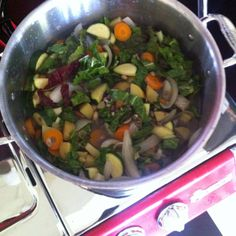 Magic Summer Soup: chard, sweet onion, sprouted live bean mix, yellow potatoes, carrots, zucchini! Bay leaves, lemon verbena, salt and garlic!  Farmers Market deliciousness!