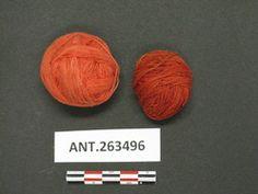 YPM ANT 263496 -Two balls of red yarn; dyed using lime and vegetable dyes--qibayat qan napudun qan mumbolah; Field #E84.1346; Bayninan, Banaue, Ifugao, Philippines. Yale Peabody Museum of Natural History