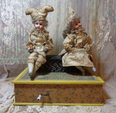 CHOICE antique German automaton toy-1889. Works wonderfully-turn the crank, it plays a tune and the children move arms and heads. Rare.  2700.00