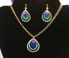 Quilled earrings and pendant.
