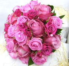 A beautiful mix of Pink Roses, differing varieties add interest & texture - finished with beaded wire