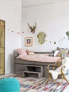 the boo and the boy: eclectic kids' rooms Love the gray bed and the rug. Great chair with sheepskin.