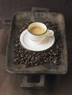 A Cup of Espresso on a Wooden Bowl with Coffee Beans Photographic Print by Anita Oberhauser at AllPosters.com