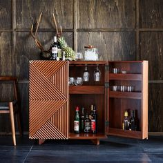 Created in collaboration with Melbourne-based designer Rosanna Ceravolo, this bar cabinet's geometric patterned facade gives it texture and subtle depth. With a solid wood base and roomy cabinets, it's a storage piece and a work of art.