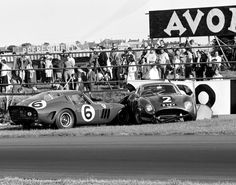 The wreckages of John Surtees's Ferrari 250 GTO and Jim Clark's Aston Martin DB4GT Zagato, on the grass of the 1962 Tourist Trophy race.