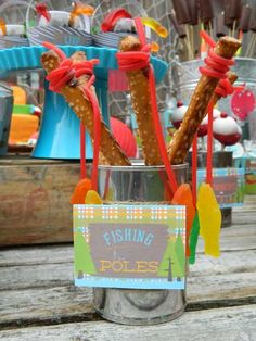 Fishing Pole Pretzels with swedish fish and pull apart twizzlers at boy themed gone fishing party