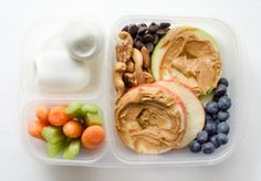 """Apple and Peanut Butter """"Sandwiches"""" Blueberries Cashews + almonds + pecans + dark chocolate chips Boiled eggs Carrots + celery"""