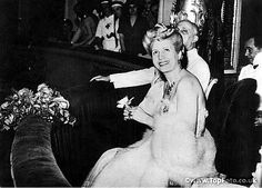 Eva Peron smiles in acknowledgement as she holds a flower thrown to her at a gala performance at the famous La Scala theatre in Milan. 1947