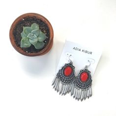 Silver Boho Pendant Earring Burnished silver tone pendant earrings with a orange red stone and a metal fringe. Great for the upcoming festival season--Coachella perfect! Metal alloy. Brand new. Please carefully review each photo before purchase as they are the best descriptors of the item. My price is firm. No trades. First come, first served. Thank you! :) Adia Kibur Jewelry Earrings