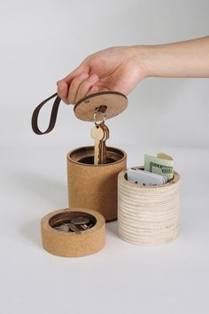 Grab & Go Carry All by Bud Nitaya  Nitaya's bamboo storage system design is divided into two parts that can store loose change, keys, and credit cards, and is conveniently mobile thanks to a leather strap