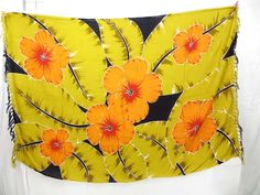 yellow leaf and orange flower sarong $4.95 - http://www.wholesalesarong.com/blog/yellow-leaf-and-orange-flower-sarong-4-95/