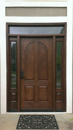 New Therma Tru Classic Craft door with Longford glass decorative sidelites and matching overlay on the transom. Fiberglass doors look like wood, but are 5x as energy efficient!