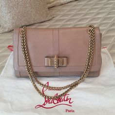 Christian Louboutin Large Sweet Charity bag Christian Louboutin Large Sweet Charity bag. Nude exterior and red interior. Absolutely stunning and makes a statement. EUC Christian Louboutin Bags Shoulder Bags