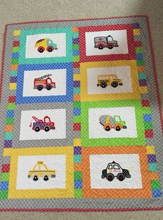 Machine embroidery appliqué baby quilt made with designs from ETSY AppliquetionStation.