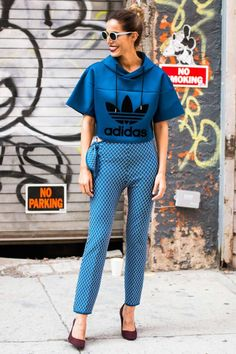NYFW Street Style is serving up lots of inspiration, like this sporty hoodie look paired with cool tailored trousers in a coordinating color.
