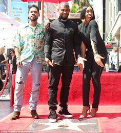 Fancy: Fellow artist Kelly Rowland also attended, dressed in black trousers and a loose fitting blouse; pictured with Miguel and Usher