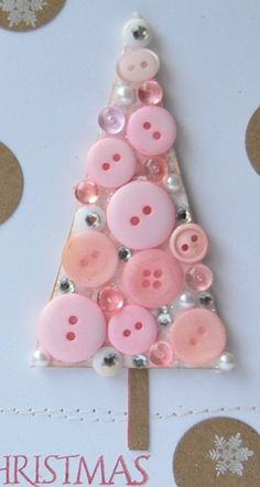 Buttons cover a felt Christmas tree shape for an ornament