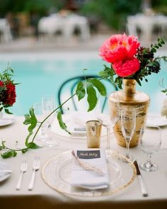 A picture perfect place setting for this jewel-toned vintage Hollywood wedding. Get more ideas by following the link to the complete wedding gallery!