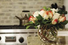 round fish bowl vase with roses kitchen