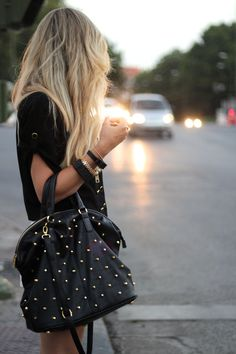 Big purses are a must have in a girl's closet, edgy style with a studded black leather purse