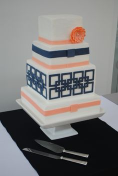 """Navy wedding cake with """"Cat's Cradle"""" design from table runner fabric and invite enclosure"""