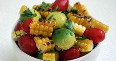 Grilled Corn, Avocado and Tomato Salad    I was looking for a light, and bright tasting salad to go with pulled pork sandwiches and beans....