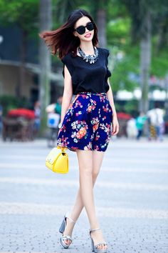 A black silk sleeveless top and a blue floral skater skirt make for the perfect base for an absolutely stylish casual look. Put a classier spin on an otherwise all-too-common ensemble by rocking a pair of silver embellished leather heeled sandals. Love Fashion, Fashion Outfits, Womens Fashion, Fashion Trends, Pretty Outfits, Cute Outfits, Floral Skater Skirt, Skirt Outfits, Spring Outfits