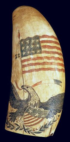 Scrimshaw whale's tooth with spread-wing eagle clutching a shield.