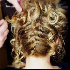 French braid updo, had this once for a wedding & i love it. Probably my favorite updo.