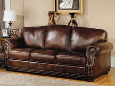 Google Image Result for http://www.alcazarfurniture.com/assets/images/Parker_House/Parker_House_Living/Albany/Leather-Walnut-Sofa-Albany.jpg  This sofa would go insanely well in my study, its classic!