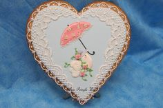 Love is in the Air, heart with cute love bird, umbrella, and perfectly piped lace by Teri Pringle Wood, posted on Cookie Connection