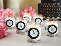 Warm up your table décor with these classy monogrammed candles. Use scrapbook paper, ribbon and cool buttons to create this simple project for your reception.