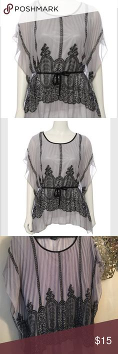 Pleated gray black lace design top Pleated top with tie waist cute on with black pants. Batwing sleeves Rue 21 Tops Blouses