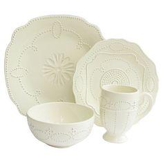 Sixteen-piece scalloped earthenware dinnerware set with a textured geometric motif.  Product: 4 Dinner plates 4 Sala...
