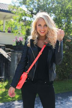 Blond curls red bag black clothes smiling emilie nearing