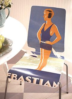 Decoupage of midcentury chair with large vintage poster!