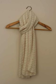 Yarn: Approx 680m of 4ply / Fingering weight yarn Hook: 3.00mm Dimensions: Before blocking: 210 cm x 27cm Note: Work the first half of this scarf then rejoin yarn into back of foundation chain a…