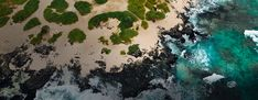 An aerial view of the ocean waves washing upon rocks and sand. Hawaiian Luau, Hawaiian Islands, Hawaii Flights, Flight Sale, Southwest Airlines, International Flights, Waikiki Beach, Pearl Harbor, Types Of Plants