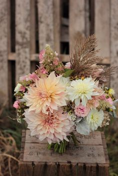 Soft romantic blush autumn bridal bouquet with Cafe au Lait dahilas and grasses. Grown and designed by Love 'n Fresh Flowers.