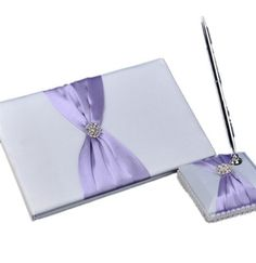 Artwedding Rhinestone Wedding Guest Book and Pen SET Elegant GUESTBOOK, White and Lilac by Lovevox, http://www.amazon.ca/dp/B008CC5UK8/ref=cm_sw_r_pi_dp_QPR.qb15RZPQ6